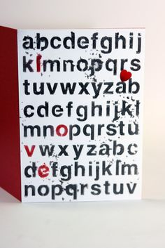made the word LOVE red and covered the whole alphabet with  translucent embossing paste from studio 490