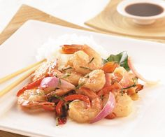 Stir-fried shrimp with lime leaves, chilis and garlic by Darryl Mickler. Photo by Chris Cassidy.
