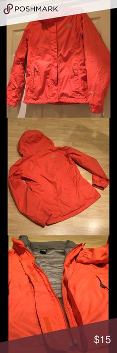 North Face hooded rain jacket Awesome jacket in a gorgeous, vibrant orange that gets lots of compliments! Zipper unfortunately got slammed in the door so the zipper pull did fall off but could be an easy fix. Jacket still does Velcro shut. There is also a tiny hole in the right pocket which is shown in last photo. Make an offer! North Face Jackets & Coats