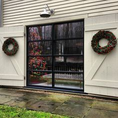 Library room, modern window, barn doors, Christmas Tree, symmetrical magnolia wreaths flanking the window Windows And Doors, Steel Windows, Black Windows, Modern Windows, Farms Living, Bars For Home, Modern Farmhouse, Library Room, Barn Doors