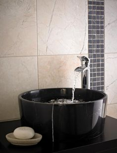 Sorrento polished marble tiles look beautiful in the bathroom, especially when contrasted with a mosaic stone border.