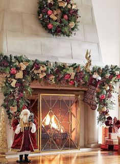 In a stunning balance of regal splendor and natural beauty, a lifelike blend of cypress and pine is appointed with glass ornaments, faux roses and berries in rich shades of burgundy. From the embellished gold ribbon woven throughout the greenery to the gilded leaves and grass, every element in the Renaissance Indoor Cordless 6 ft. Garland is carefully crafted, then arranged by hand for a full, dramatic look. Fireplace Garland, Christmas Fireplace, Christmas Mantels, Christmas Home, Christmas Decorations, Christmas Ideas, Holiday Decorating, Holiday Ideas, Christmas Crafts