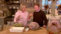 Martha Stewart and actor Jesse Tyler Ferguson stuff and tie off a turkey for Thanksgiving.