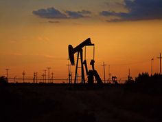 Sunset in the oil patch  by John Tucker (Chasqui01)