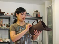 Ashley Kim in her studio. Kim's studio is featured in the May 2015 issue of Ceramics Monthly: http://ceramicartsdaily.org/ceramics-monthly/ceramics-monthly-may-2015/