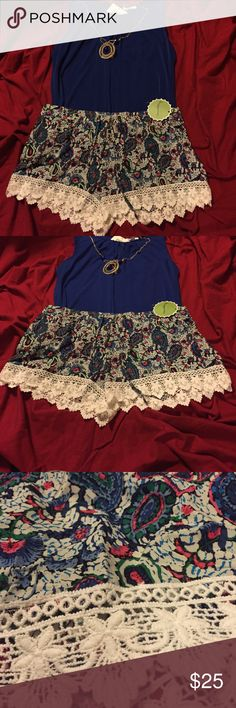 NWT....light, flowy, super cute shorts with lace NWT.....light, flowy, white with blue, green, and pink pattern. White lace around the leg. Never worn. Size XL Shorts