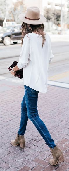 street chic. blue jeans. white blouse. hat. block heeled ankle boots.