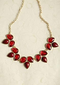 red bib necklace with gold chain by ruche