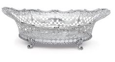 A DUTCH SILVER CAKE BASKET  19TH CENTURY, BEARING SPURIOUS MARKS FOR ROTTERDAM, 1771  Oval, on four scroll feet with foliate joins, the sides pierced with lattice work and garlands, marked under base  15¼ in. (38.7 cm.) long; 31 oz. 10 dwt. (983 gr.)