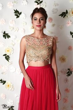 Gold net blouse with rose tutu skirt with scattered mirror work by Renee label