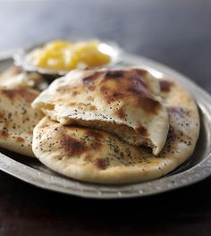 Naan breads, flavoured with garlic and fresh coriander, are quick and easy to make