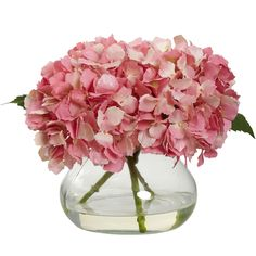 """Blooming Hydrangea w/Vase - Capturing a blooming hydrangea in all of its glory, this wonderful silk arrangement will add a touch of sunshine to any area. Standing a compact 8.5"""" high, it's not too big, nor too small, but just right for your decorating needs. Besides the soft, full blooms, this piece comes with an attractive vase compete with liquid illusion faux water – it'll stay fresh looking for years. Available in four colors, it makes a great gift as well. Number of Trunks: NA Number of"""