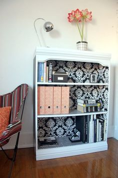 Love the idea of adding Wallpaper to the back of bookshelves. Since I am cheap, Ive been using wrapping paper and double sided tape! I think its a good idea to put it on glass doored cabinets in areas where you dont want em to see clutter!
