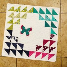 made this mini for my #schnitzelandboominiquiltswap partner using @vchristenson's #simplycolorful2fabric and @lillyellasworld #butterflycharmblocks pattern by marmaladeinstead