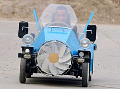 A wind-powered car emerges from a farm in China - Tang Zhenping, the proud designer who happens to be a farmer as well, said that his wind-powered car has a range of about 86 miles, reaching speeds up to 140 km/h – quite an impressive feat considering the materials used.