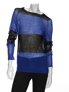 @intermix #A.L.C had made a #colorblock, blue & black that you can wear through the seasons to come, cobalt blue & black sheer long sleeve treasure