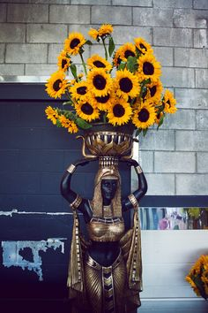Egyptian statue decor with sunflower bouquet - vintage LA wedding at The Smog Shoppe photo by top Orange County wedding photographer Duke Images Egyptian Wedding Dress, Egyptian Party, Greek Statues, Angel Statues, Backyard Wedding Dresses, Dress Wedding, Small Yard Kids, Wedding Photo Gallery, Duke Images