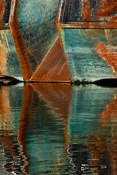 Harbor Geometry .... boats reflecting in water...deep teals and burnt oranges