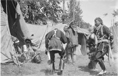 This photo by an unknown photographer shows a group of Ho-Chunk, or Winnebago, Indians at pow wow in Wisconsin, 1907. National Anthropological Archives, Smithsonian Institute. BAE GN 4413