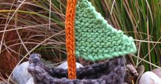 I did some yarn bombing today and knitted up a little sailboat. I really do enjoy boats, the way they glide through the water and all that.....