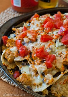 Buffalo Chicken Nachos are the perfect game-day appetizer! This recipe uses our popular Slow-Cooker Pulled Buffalo chicken - so easy and so delicious!