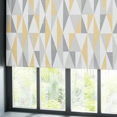 Patterned with a geometric triangle print in a grey and ochre colourway, this contemporary roller blind features full blackout coating and is available in a sel. Kitchen Blinds Sage, Roller Blinds Kitchen, Roller Blinds Design, Modern Blinds, Triangle Print, Triangle Design, Rollo Design, Triangles