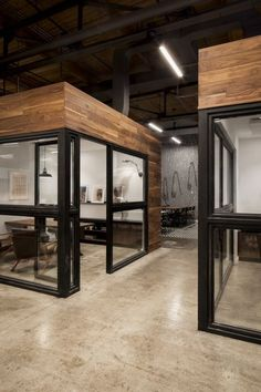 These glass-walled workrooms provide personal space without feeling stifled or claustrophobic #smallofficedesigns