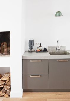 I love this kitchen and the idea of a trendy fire place