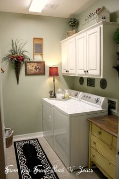 This laundry room is beautiful but the lamp on the dryer might be overkill.