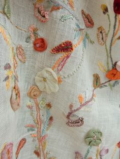 20 x 52 inches of cream linen voile, appliqued and embroidered meadow flowers on 15 inch hems. Charming !