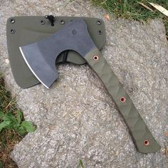 """BRT Bladeworks Huntsman Axe 1/4"""" 4140 carbon steel with OD green g10 scales. The tubes are flared copper."""