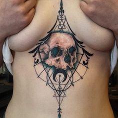 http://www.revelist.com/arts/underboob-tattoos/5179/Blue shading really makes this skull pop./19/#/19