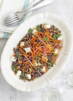 Camargue red rice salad with feta and pine nuts