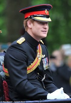 Prince Harry, wearing his new KRVO neck ribbon and emblem below his medals for the first time. Trooping the Colour, 2015