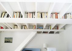 Bookshelves and staircase combined. Apartment Therapy house tours are usually good for tips for compact living combining function and style. Also from Apartment Therapy, another cool idea - the ceiling bookshelf. Book Storage, Hidden Storage, Diy Storage, Storage Spaces, Book Shelves, Storage Ideas, Extra Storage, Storage Solutions, Creative Storage