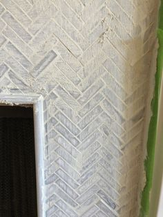 How to Add Herringbone Marble Tile to a Fireplace - Southern Hospitality Herringbone Fireplace, Granite Fireplace, Grey Fireplace, Marble Fireplaces, Fireplace Surrounds, Fireplace Ideas, Tile Around Fireplace, Granite Polish, Granite Cleaner