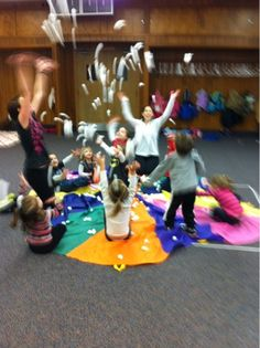 Parachute Game - Pretend snow is falling (winter activity)  Use cotton balls for snow and a parachute. Sing a song and let children's imagination run wild while having fun with snow.
