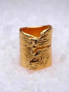 Gold Bark Tube Ring <3. LOOKS LIKE A USED BAND AID. What's the big deal?
