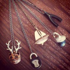 Beer (bear x deer), Lock, Sailboat, Acorn, & Wishbone Pendants! #omericaorganic #woodjewelry #madeindenver