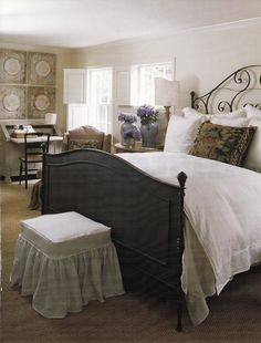 Interior Designer Shannon Bowers Dallas Home-  I'd swap out headboard, ottoman, and large bed pillow. Love the vintage tin tile, desk area, and bedside lamp.