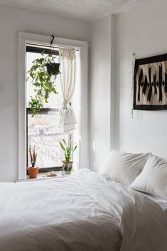 all-white bright + airy bedroom
