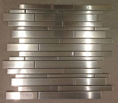 Check out our large selection of glass tile! Stainless Steel Mosaics new in stock! Stainless Backsplash, Kitchen Backsplash, Kitchen Cabinets, Mosaic Tiles, Wall Tiles, Mosaics, Kitchen Redo, Kitchen Ideas, Kitchen Designs
