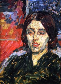 When Jawlensky painted the portrait of Madame Curie in 1905, he was still searching for artistic direction. The image is surprisingly realistic, his former training. He brightens the effect of the dark dress by introducing bright red, white, and yellow into the background, and the crowded colors, together with a painting hanging on the wall behind Madame Curie, provide an impression of opulence. In 1905, after the Nobel Prize, the Curies achieved a sort of celebrity status in France.