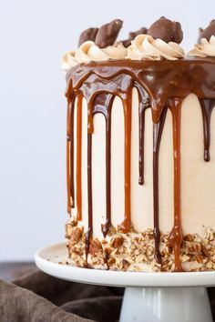 Transform your favorite candy into this Turtles Layer Cake! Layers of rich chocolate cake, caramel buttercream, caramel sauce, and chopped pecans. Salted Caramel Chocolate Cake, Chocolate Caramels, Food Cakes, Cupcake Cakes, Cupcakes, Cookie Recipes, Dessert Recipes, Desserts, Drip Cakes
