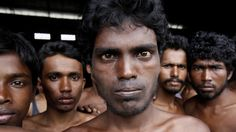 Newly arrived Rohingya migrants gather at Kuala Langsa Port in Langsa, Aceh province, Indonesia, on Friday after coming ashore. Most such migrants have been prevented from making port in Southeast Asia.