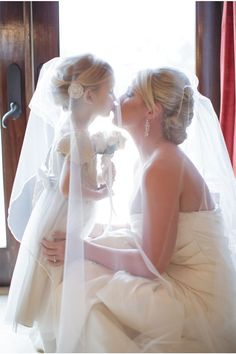 must have wedding photo ideas - bride kiss flower girl / http://www.deerpearlflowers.com/getting-ready-wedding-photography-ideas/3/