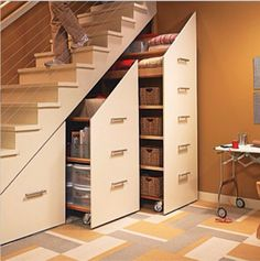 I've seen this before on a home improvement show, and think it is a great way to save and use space. pantry ideas space saving Under-Stair Storage Cabinets Home Improvement Show, Home Improvement Projects, Stair Makeover, Stair Storage, Hidden Storage, Extra Storage, Secret Storage, Staircase Storage, Basement Storage