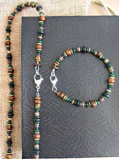 Men's striking beaded necklace is designed with green jade plus complimentary beads of coco, horn, and golden brass. The intense look of the dark Irish theme is achieved through nice beading patterns