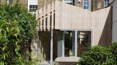 Larch extension by Pamphilon echoes London residence's butterfly roof Glass Extension, Roof Extension, Extension Ideas, Grand Designs Magazine, Butterfly Roof, Architects London, Arched Doors, Roof Architecture, Interesting Buildings