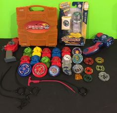 Large BEYBLADE Lot Over 30 Pcs Case Launchers Rip Cords Tops NIP Counter Leone    eBay